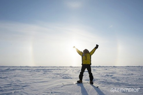 Renny reaching the North Pole, with a sun halo in the background